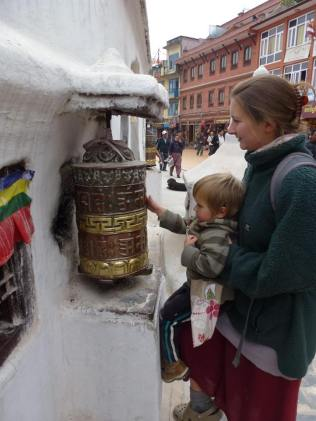 This is a prayer wheel. Inside the wheel there are hundreds of thousands of tiny prayers written down. As you pass you spin the wheels to release the prayers - a spiritual practice my 3 year old could get in to!